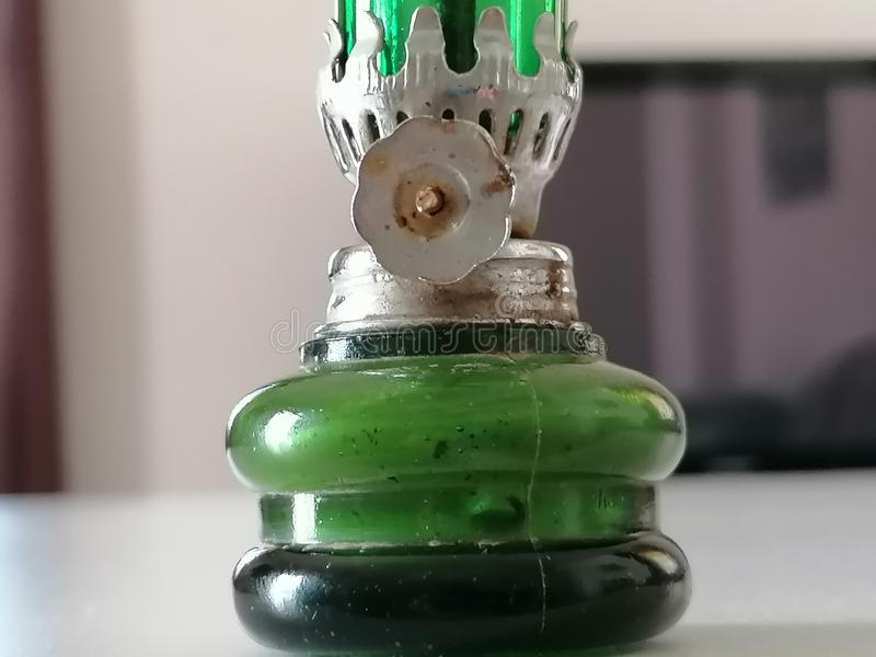 Old lamp with green glass. royalty free stock images