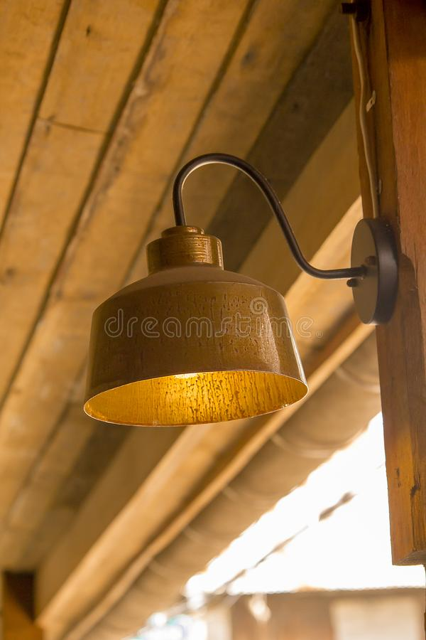 Lamp made of brass attached to the wall stock image
