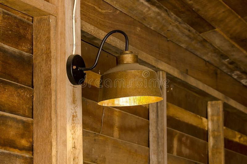 Lamp made of brass attached to the wall stock photo