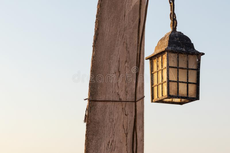 Old lamp next to the coast, idyllic scene from the ancient times of fishing. Africa. Angola. Namibe stock photos