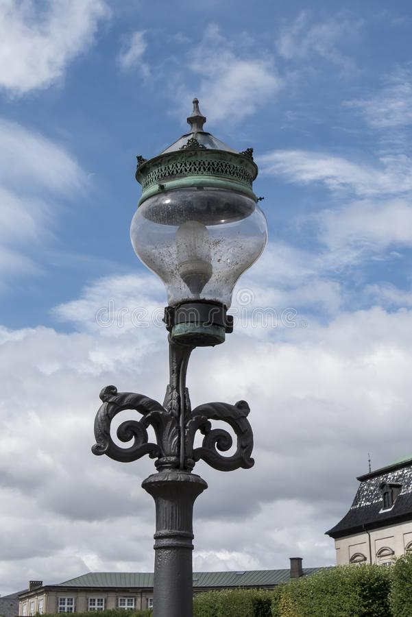 Old lamppost in a street of copenague royalty free stock photos