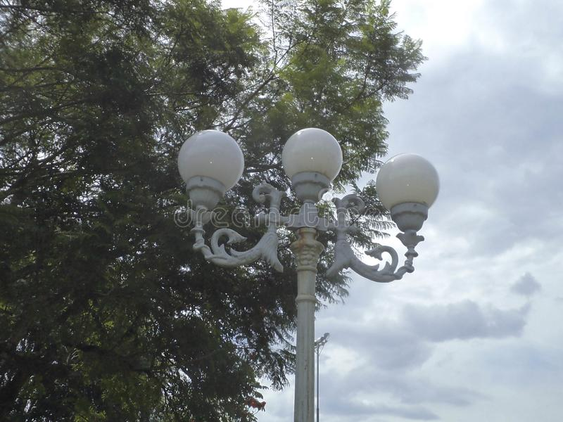 Old lamps. Old luminaires, with iron support, in the square of the city of Cocais, Municipality of Barrão de Cocais, in Minas Gerais stock images