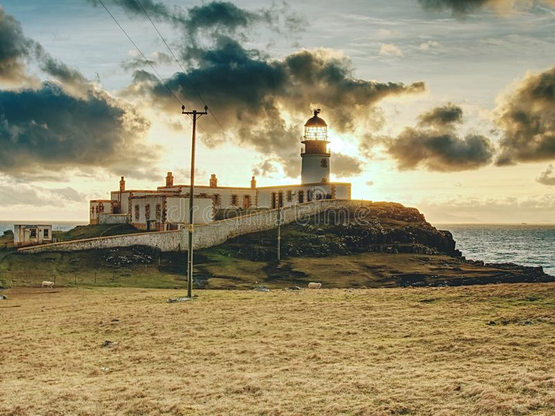 Old landscape lighthouse, white light tower with building for navigation on the thin spit of island royalty free stock photos