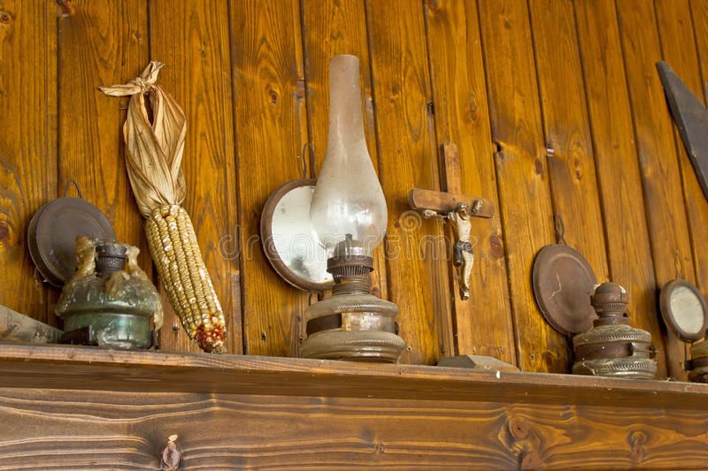 Old lantern, crucifixion, corncob and paraffin lamp stock images