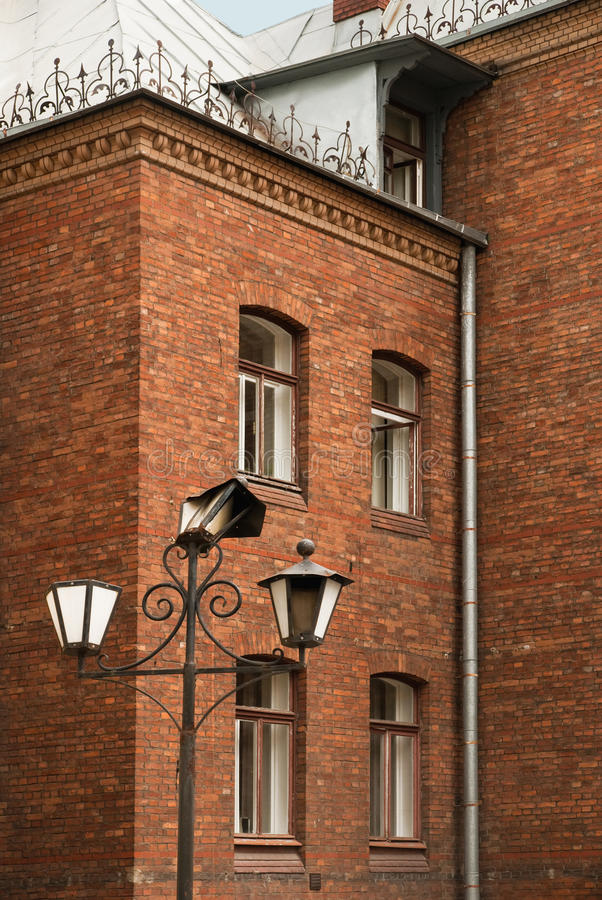 Free Old Lantern In A Court Beautiful Brick House Stock Photo - 31620420