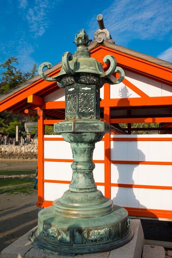 Old lantern at  Itsukushima Shrine at Miyajima island. Hiroshima, Japan royalty free stock photo