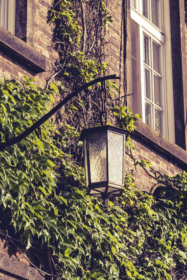 Old lantern, medieval street light  in the street on the light background in Krakow. Poland royalty free stock photo