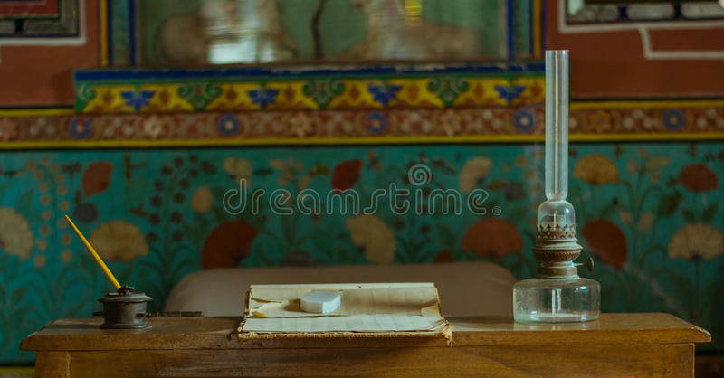 Old lantern, pen, table. royalty free stock images