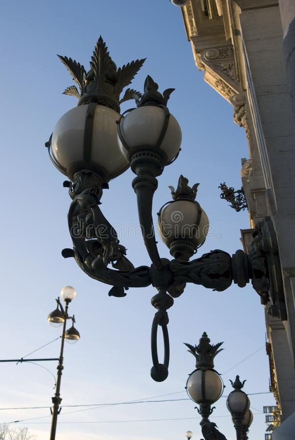 Old lanterns. Architecture of the Nevsky prospect in Saint-Petersburg, Russia. Old lanterns. Architecture of the Nevsky prospect, popular touristic street in royalty free stock images
