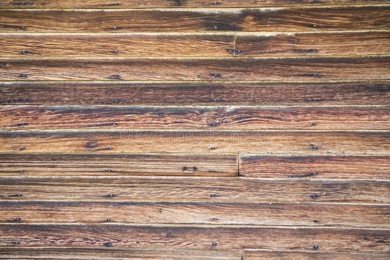 Old lap wooden siding rusty nails stock photo