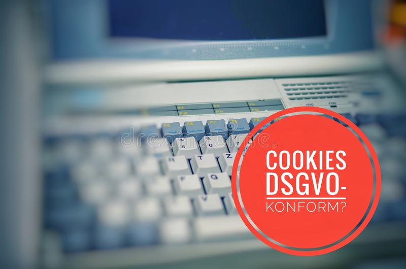 Old Laptop with inscription in german Cookies DSGVO-konform in english Cookies GDPR compliant to symbolize the General Data Protec. Tion Regulation in german stock images