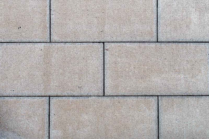 Old large concrete block brick wall or footpath texture background royalty free stock photo