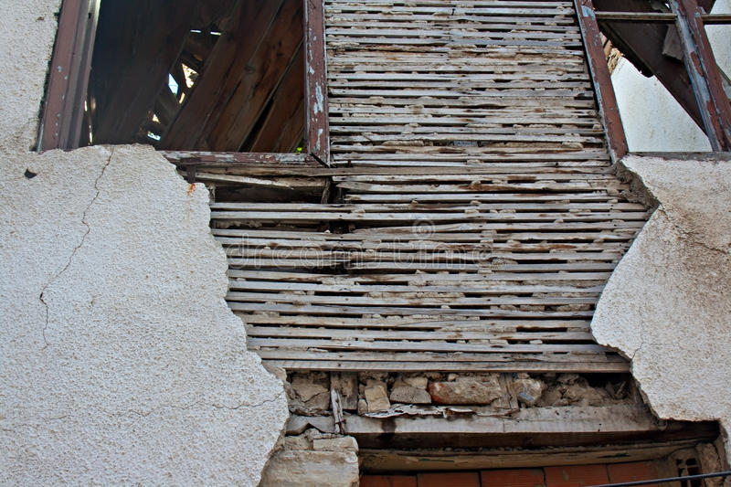 Old lath and plaster on derelict building. Old lath and plaster on exterior of old derelict house stock image