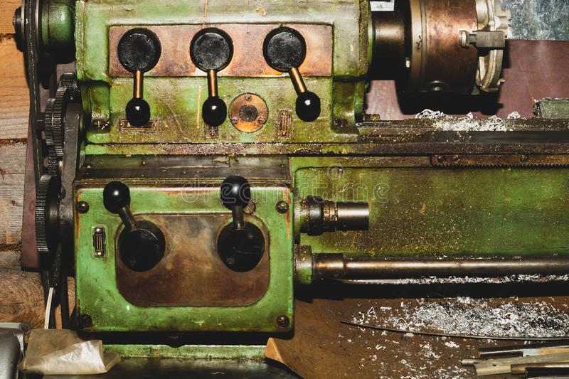 Old lathe. detail of rusty machine. metal mechanism. vintage metalworking machine close up. industrial background stock images