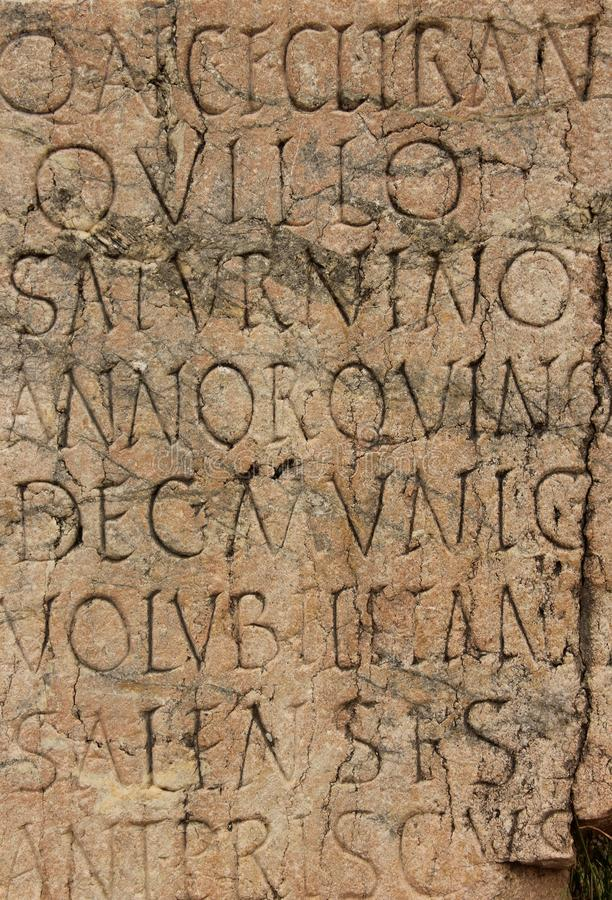 Old Latin Writing. A stone slab engraved with old Latin writing at the ruins of Sale near Rabat, Morocco stock image