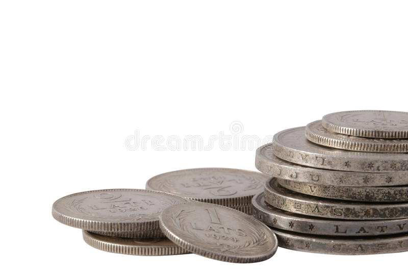 Old Latvian lats silver coin stack. Isolated on white royalty free stock images