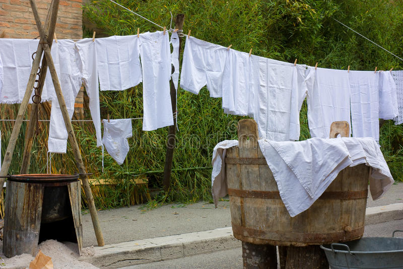 Old laundry. Old underwear hanging out to dry - hang out the washing - clothes-line with ancient linen - ancient vat of laundry royalty free stock photography