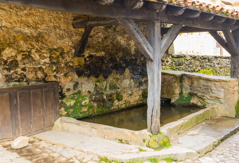 Old laundry room. Old laundry where women washed soap-based clothes and brushed the fabric against the stone system that in Spain in which towns were exercised stock photos