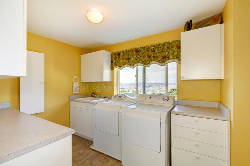 Old Laundry Room With White Cabinets And Yellow Walls. Stock Image ...