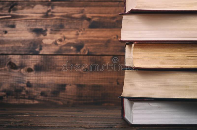 Law books on the brown walnut wooden background. royalty free stock photo