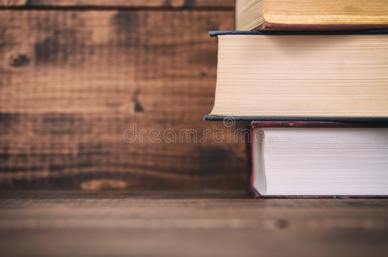 Law books on the brown walnut wooden background stock photos
