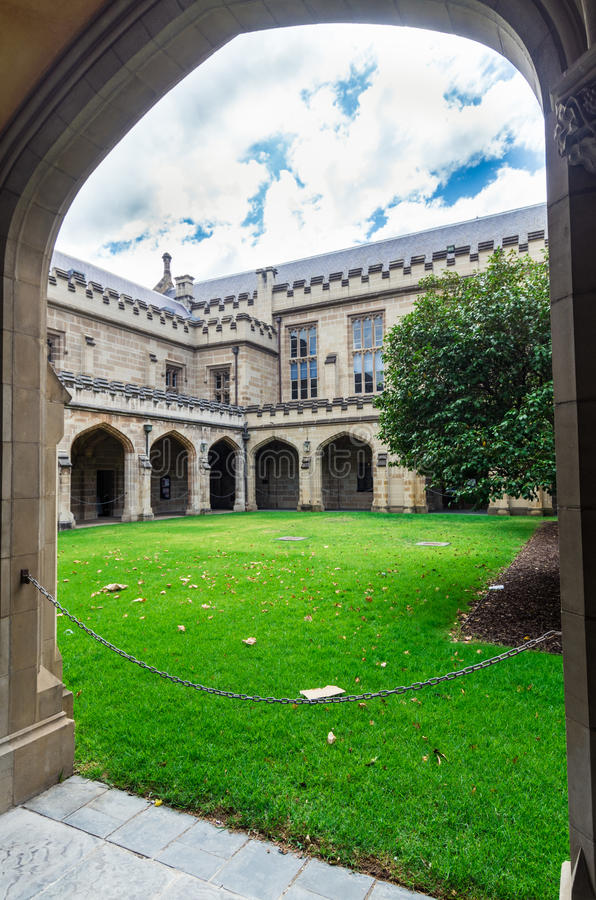 Old law quadrangle at the University of Melbourne, Australia. Old sandstone buildings with elegant arches make up the old law quadrangle at the University of royalty free stock images