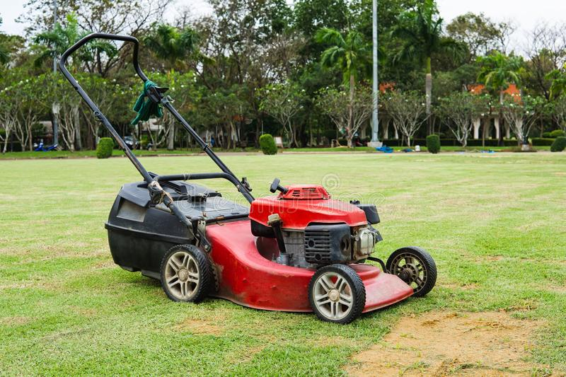 A old lawn mower machine on Grass field stock photography