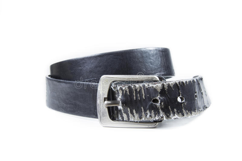 Old leather belt torn on white background. Old leather belt torn on white background stock photos