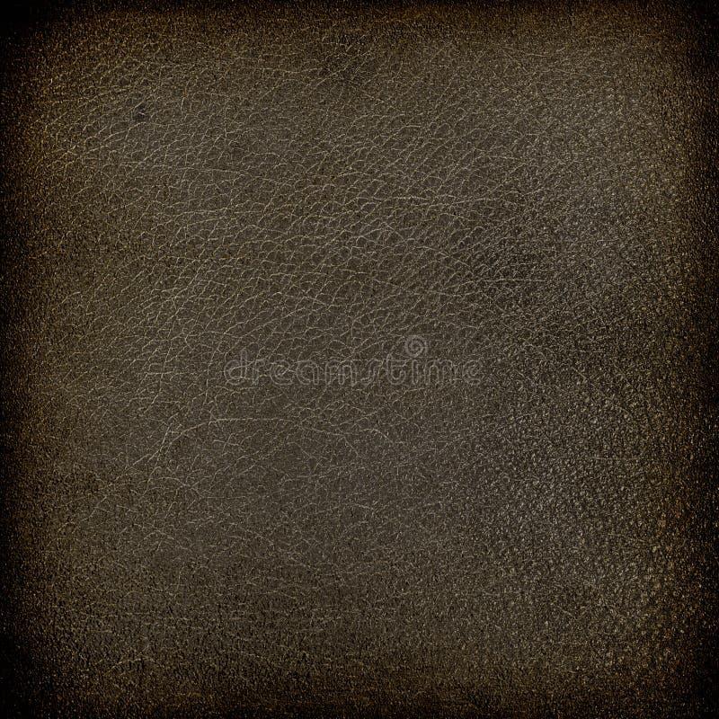 Old leather texture background dark brown color. And subtle vignette stock image