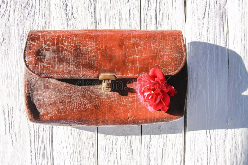 Old leather vintage reticule bag with rose.  stock image