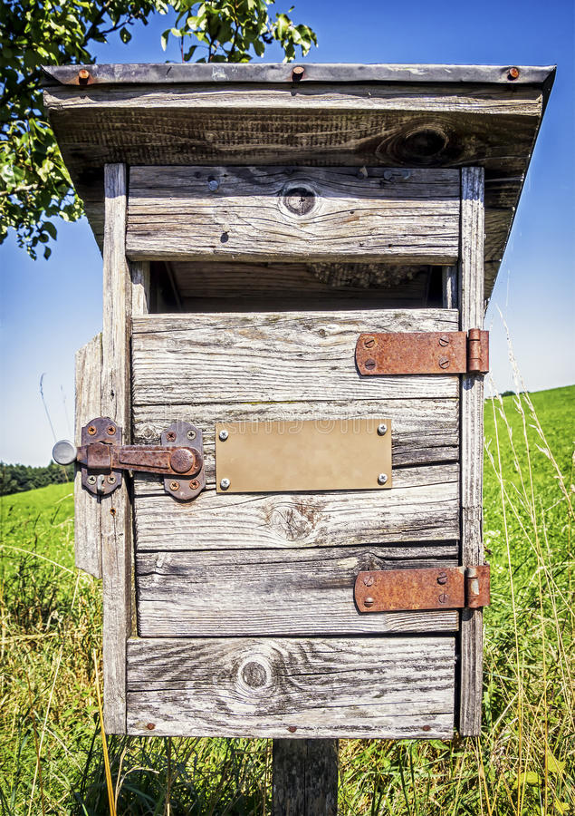 Old letterbox. Beautiful old letterbox at a meadow stock images