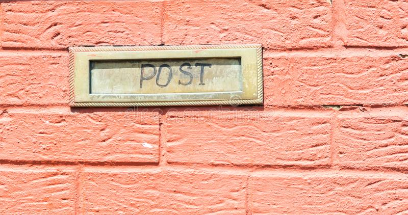 Old letterbox in the door, traditional way of delivering letters to the house, old mailbox. Correspondence royalty free stock images