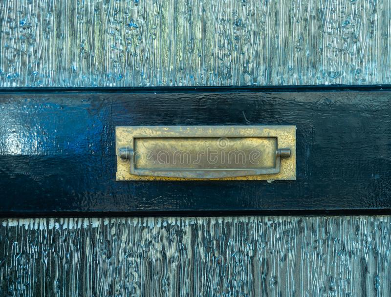 Old letterbox in the door, traditional way of delivering letters to the house, old mailbox. Correspondence stock photography