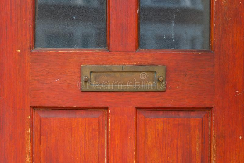 Old letterbox in the door, traditional way of delivering letters to the house, old mailbox. Correspondence royalty free stock image