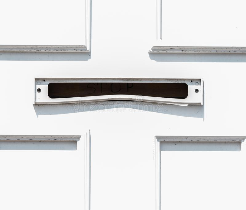 Old letterbox in the door, traditional way of delivering letters to the house, old mailbox. Correspondence royalty free stock photography
