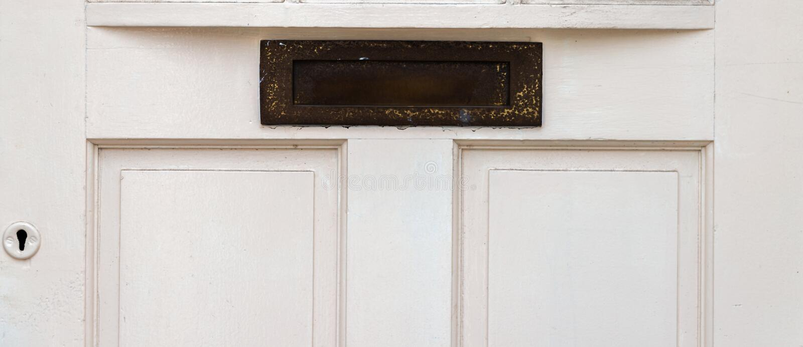 Old letterbox in the door, traditional way of delivering letters to the house, old mailbox. Correspondence royalty free stock photos