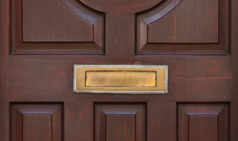 Old letterbox in the door, traditional way of delivering letters to the house, old mailbox. Correspondence stock images