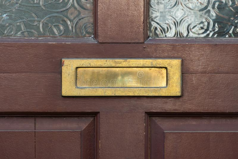 Old letterbox in the door, traditional way of delivering letters to the house, old mailbox. Correspondence royalty free stock photo