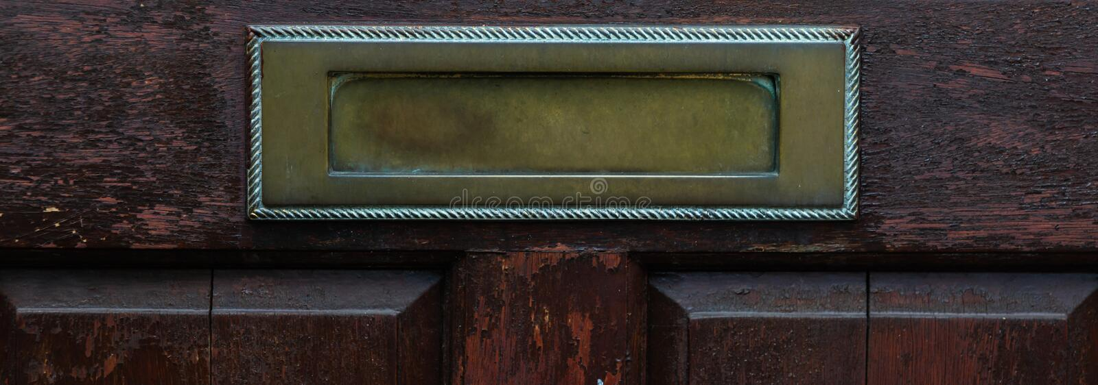 Old letterbox in the door, traditional way of delivering letters to the house, old mailbox. Correspondence stock image