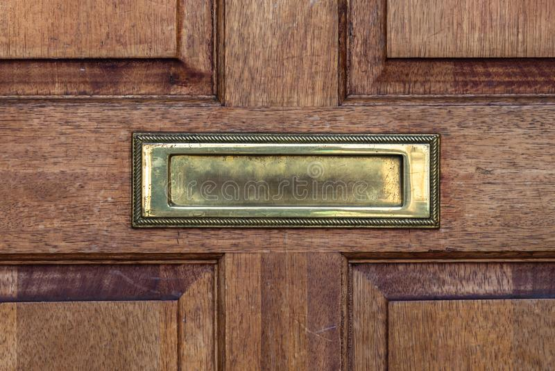 Old letterbox in the door, traditional way of delivering letters to the house, old mailbox. Correspondence stock photos