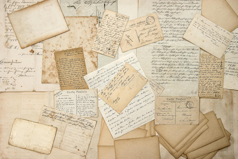Old letters, handwritings, vintage postcards. Grungy paper texture stock image