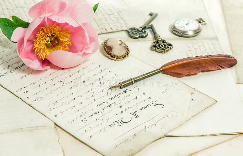Old letters, pink peony flower and antique feather pen. Vintage. Old letters, pink rose peony flower and antique feather pen. romantic vintage background stock image