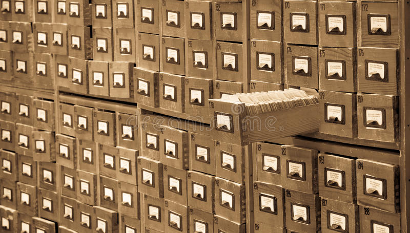 Old library or archive reference catalog with one opened card drawer. Database and knowledge catalogue concept. stock photos