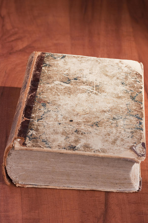 Old library book. The old library book on a book-depository table royalty free stock image