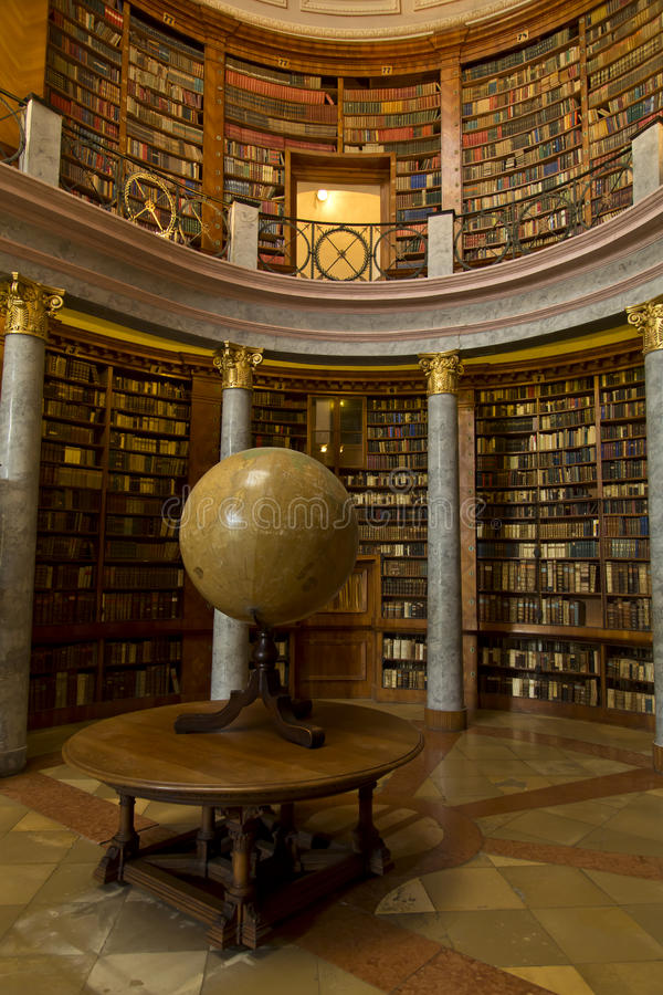 Old library with earth globe, and columns royalty free stock photo