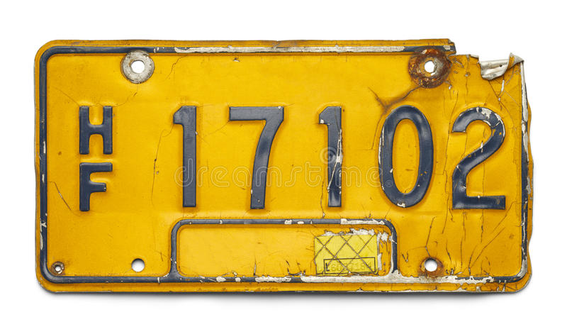 Old License Plate. Old Yellow Bent Up License Plate Isolated on a White Background stock photos