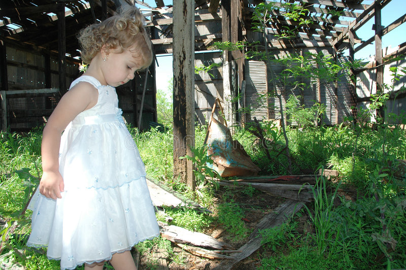 Old life and New. You wouldn't let your kids play in an abandoned barn would you? This is an image that can be used to explain dangers of life for our children royalty free stock photo