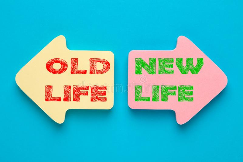 Old Life and New Life. Written on paper arrows. New life concept, dieting, healthy lifestyle and new year resolution stock photo