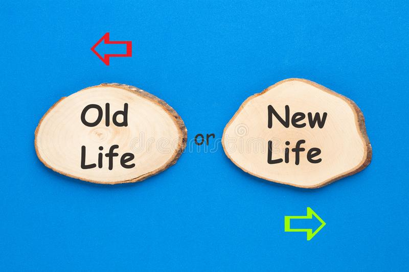 Old Life New Life Opposite Arrows. Two wooden ellipse with text Old Life or New Life on blue background. Business Concept royalty free stock photos