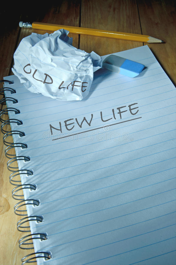 Old life vs new life. Old life handwritten on a crumpled piece of paper with new life printed on a fresh sheet stock photography